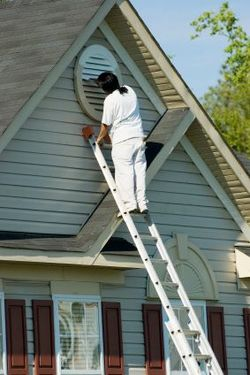 Exterior Painting being performed by an experienced Exceptional Painting painter.